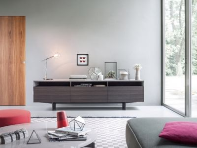 LEMA   A regular and clean volume, with a thermally-treated oak structure defines Marble Arch unit by Matteo Nunziati. Fitted with open units on the top and on the bottom closed with flap doors and drawers, it is supported by elegant lama feet in the same material.