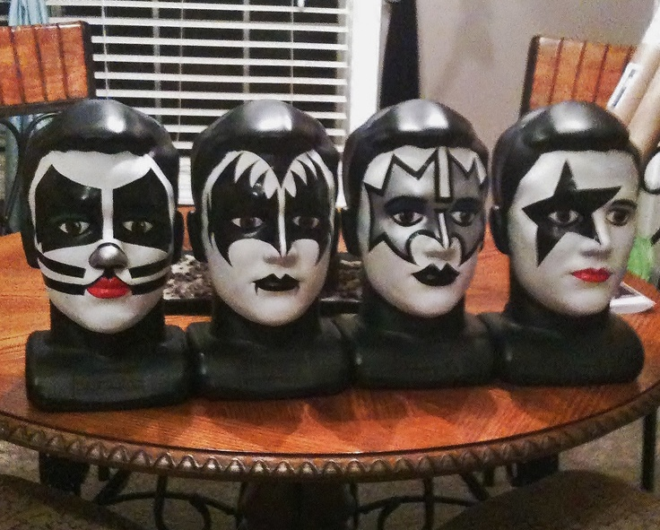 """KISS"" faces I painted on dummy heads for our sons band room"
