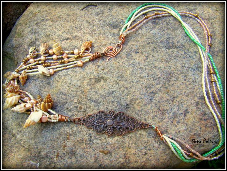 """""""Kuparisia Kuohuja"""",  """"Copper Waves"""" Necklace made of seed beads, some fresh water pearls, shells and antique copper tone filigree finding. And clasp is self made from copper wire, hoping it will darken on its own."""