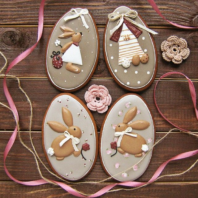 Adorable bunnies and birdhouse could be on egg shaped cookie.