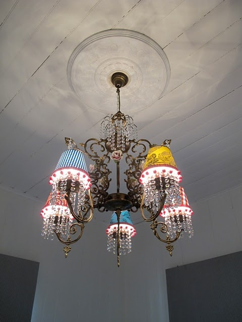 I Like The Variety Of Lamp Shade Colors Used On This Chandelier