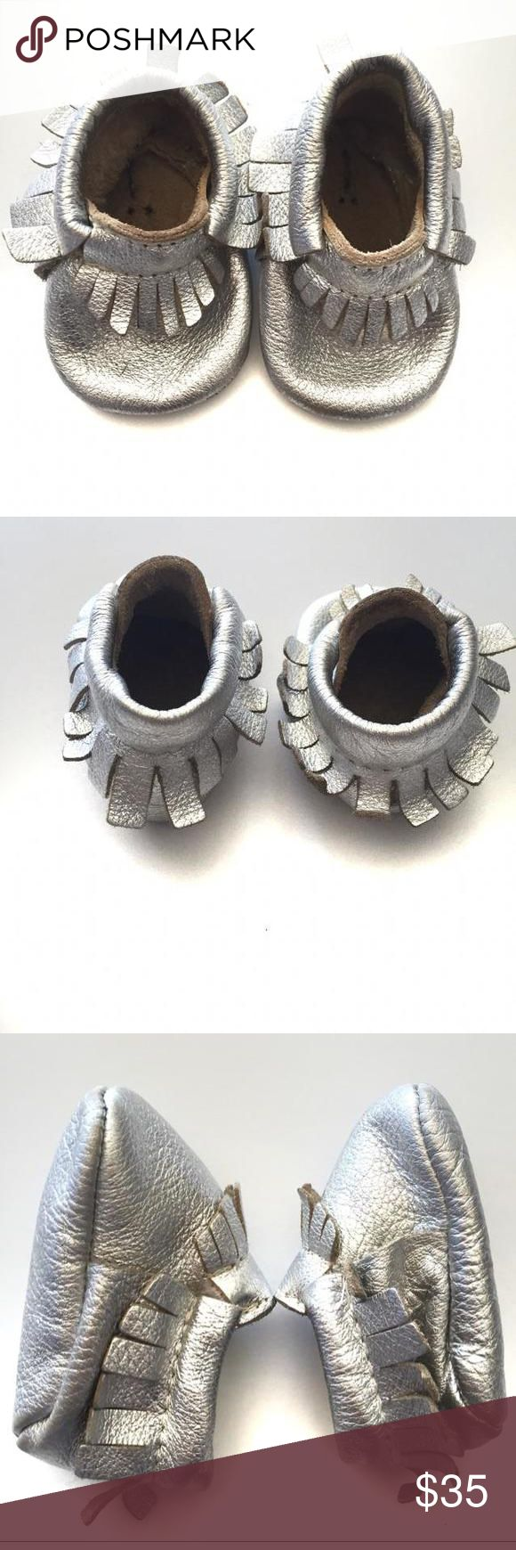 Freshly Picked Leather Mocassins These metallic mocassins are soft soled and made from 100% durable, wear-tested leather.  The elastic opening makes it easy to put it on and take it off, but will stay on your infant's foot. So chic!! Freshly Picked Shoes