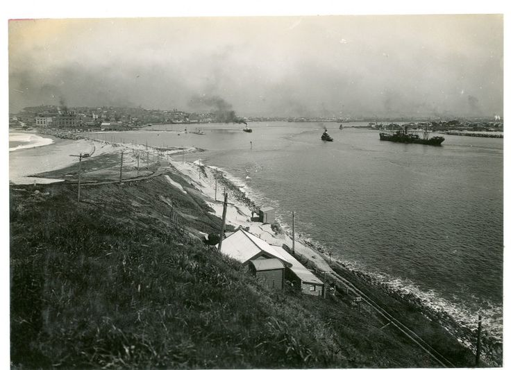 A view of Newcastle Harbour shipping entrance, from the Light House, Newcastle, NSW. http://archivesoutside.records.nsw.gov.au/tag/moments-in-time/. v@e.