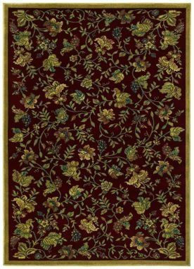 """Shaw Kathy Ireland Home Essentials Vermont Meadow 2'3"""" x 7'8"""" Garnet Runner Area Rug by Shaw. $149.00. Kathy Ireland Home Essentials VERMONT MEADOW garnet rug by Shaw Floors is a machine made rug made from synthetic. It is a 2 x 8 area rug runner in shape. The manufacturer describes the rug as a garnet 2'3"""" x 7'8"""" area rug. Buy discount rugs with Buy Area Rugs .com SKU 3x079-5278