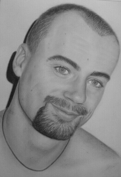 Handsome young man done in charcoal by Christine Dunn