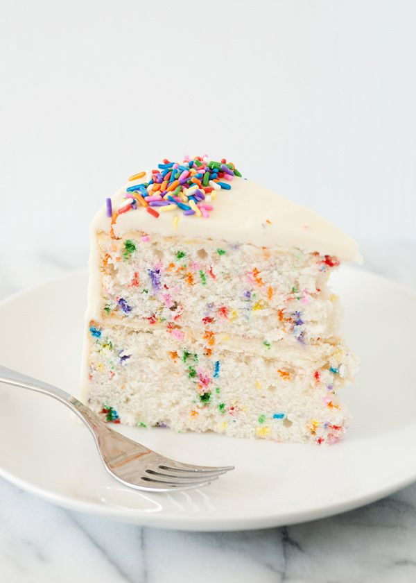 Homemade funetti cake with marshmallow buttercream.  Plus, tip for how to get flat cake layers when baking.