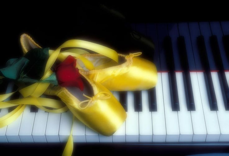 Ballet Shoes On Piano Keys Photograph by Garry Gay