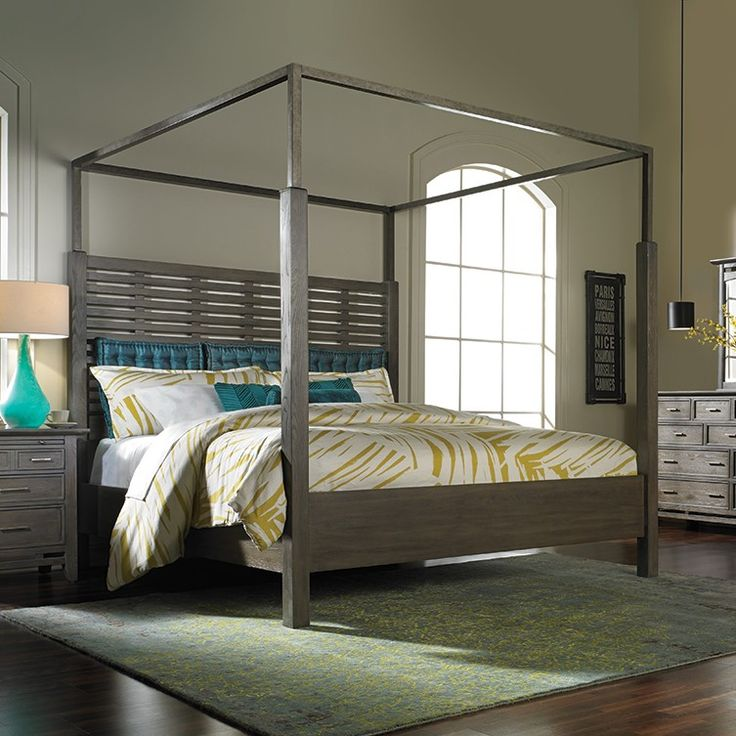 canopy bed is handcrafted from solid hardwood in a weathered grey finish