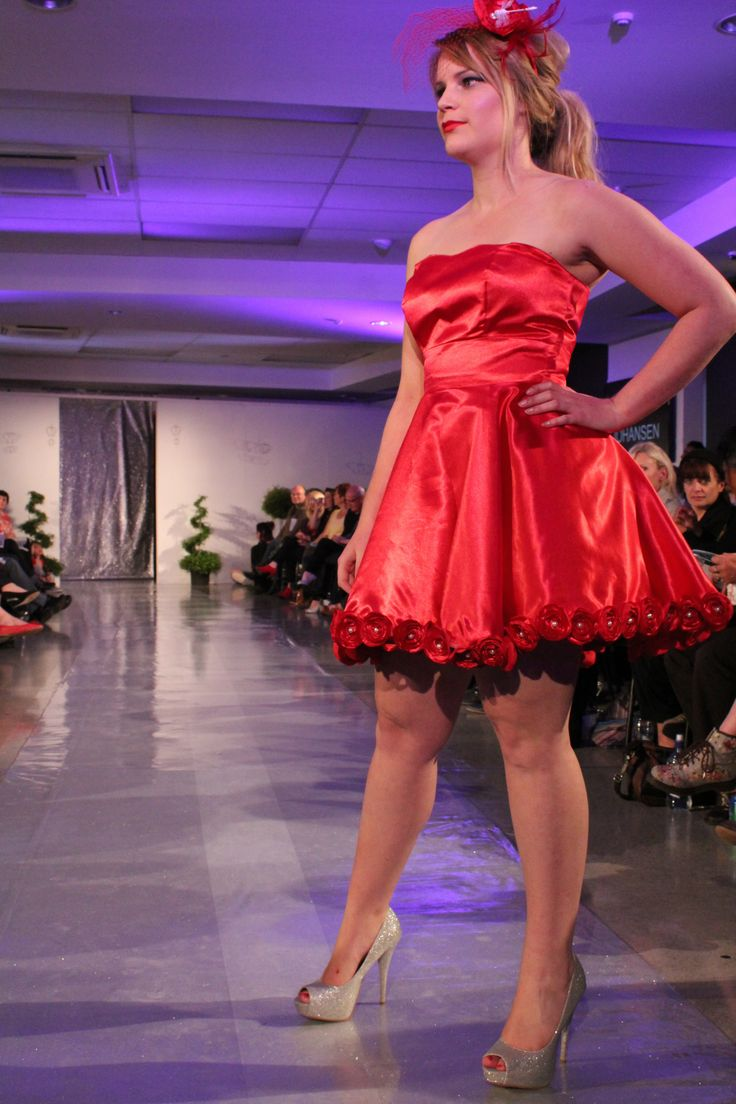 'Bed of Roses' the red dress project Strapless sweetheart dress with 71 hand made roses around the hem