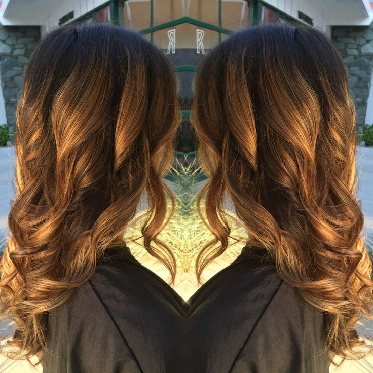 Golden blonde balayage ombré highlights with dark brown roots and loose waves done by Samantha Jo