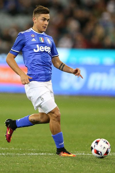Paulo Dybala of Juventus runs with the ball during the 2016 International Champions Cup match between Juventus FC and Tottenham Hotspur at Melbourne Cricket Ground on July 26, 2016 in Melbourne, Australia.