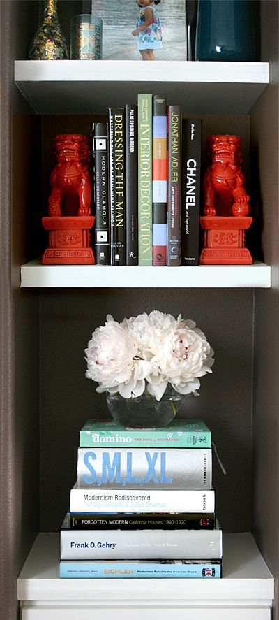 For smaller items, use books to add height.