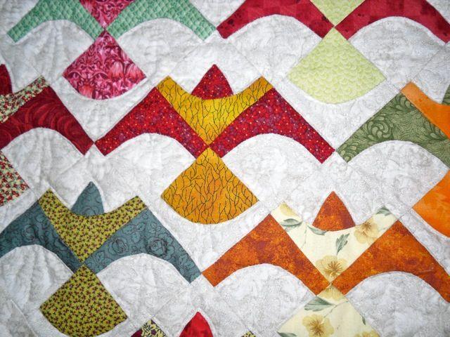 In 2004 maakte ik deze quilt. Het patroontje van de vogel vond ik in een oude Quiltnieuws. Mijn schoonmoeder kreeg de quilt cadeau met Sin...