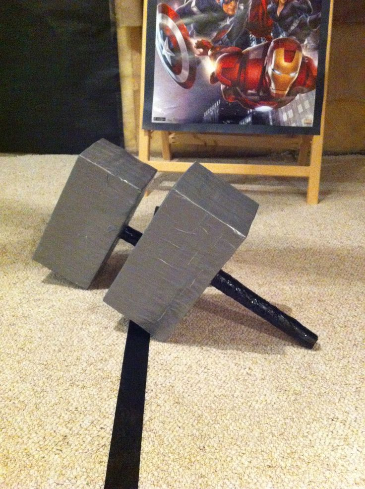"""""""Thor's Hammer Throw"""". We made these out of kleenex boxes, duct tape, paper towel rolls and electrical tape. Put something inside to weight it down though. We taped a circle in the carpet as a target. Avengers birthday party"""