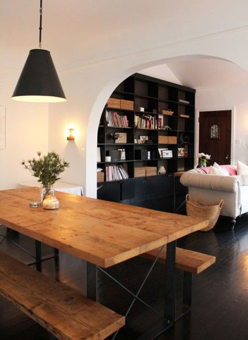 kitchen picnic table. chic and fun. rustic yet modern. in love with the dark floors and bookcase.