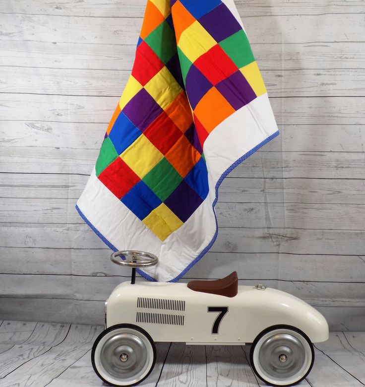 A personal favourite from my Etsy shop https://www.etsy.com/uk/listing/243554121/rainbow-baby-rainbow-quilt-colourful