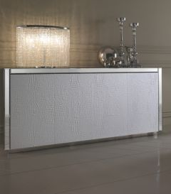Diva Collection 4 door white alligator sideboard with polished steel plinth base. Bevelled mirror surround and top.