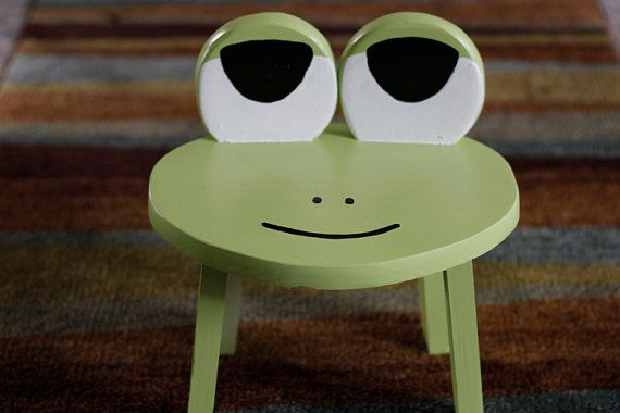 This cute little frog stool/ chair is the perfect size for small children. It is built of quality pine wood and hand painted in acrylic. The seat
