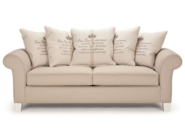 The Chester sofa features spike legs, five large pillow-back cushions and two accent pillows.  Alternatively it may be ordered with two envelope back cushions plus two toss pillows. Please note that in this case the seating is quite deep.