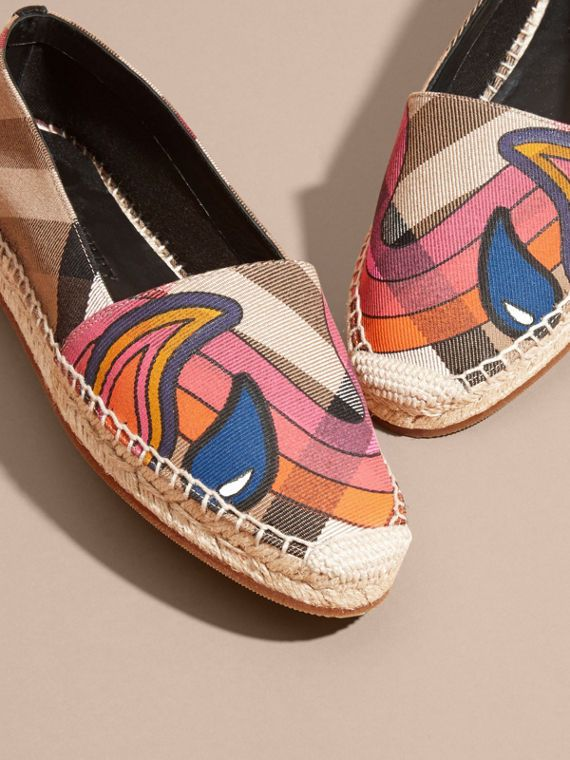 Canvas check espadrilles printed with a vibrant rainbow motif. A soft suede trim adds textural interest. The classic braided hessian-finished sole features a protective rubber base.