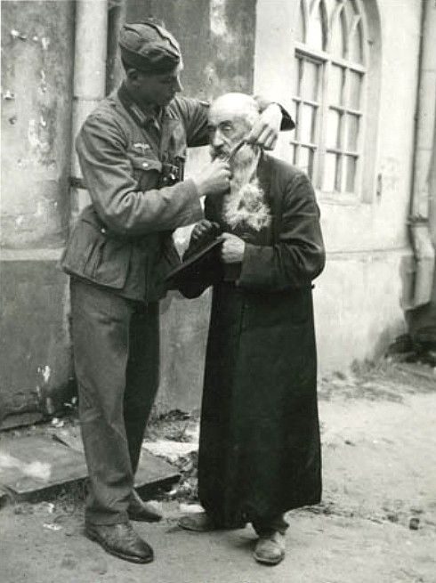 A young German soldier tries to humiliate an elderly Polish Jew by cutting his beard.  Beard-cutting was a method of humiliation favored by many Germans.  As it is with all bullies and their victims, the strong bear the real shame for preying on the weak.  The Jews of Europe bore such petty torments with exceptional dignity and fortitude.  If this soldier were still alive to look back at this picture, would he feel ashamed?  If he retained any humanity, he would.