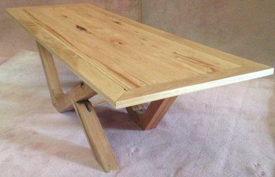 Custom Built Blackbutt Dining table, made using Australian Hardwood tongue and groove timber floorboards at Timber Floors Pty Ltd 7 Jumal Place Smithfield NSW 2164 Tel 02 9756 4242
