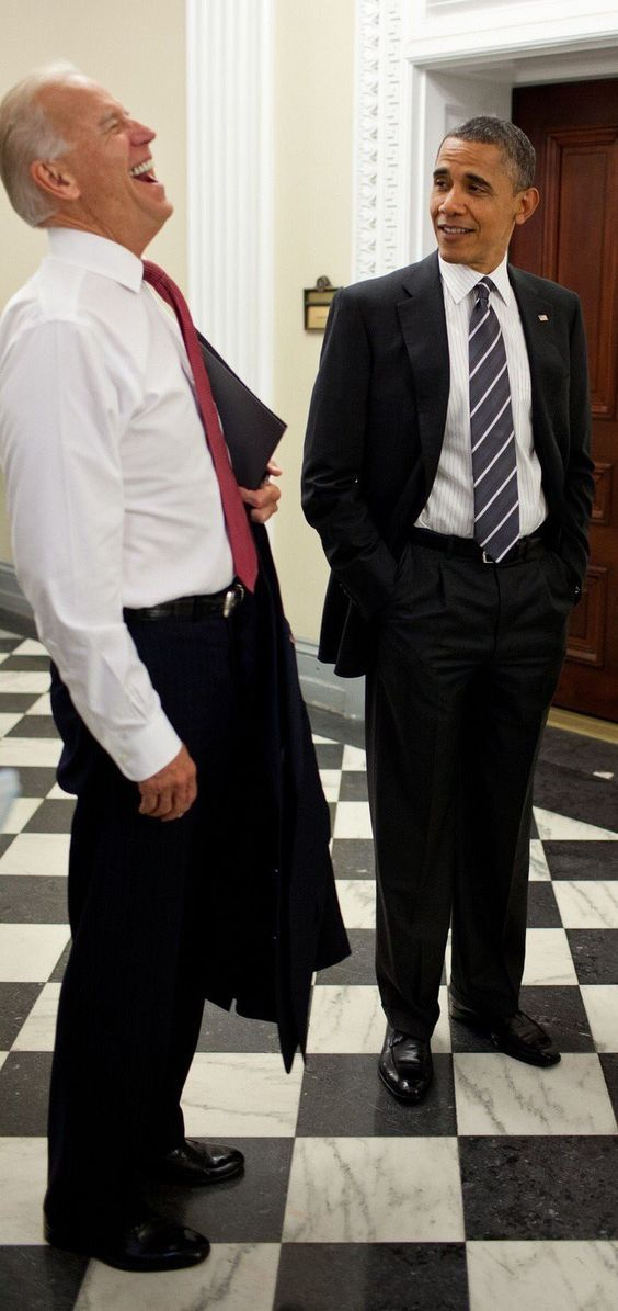 Vice President Joe Biden having a good laugh while President Obama looks on a little less amuzed.