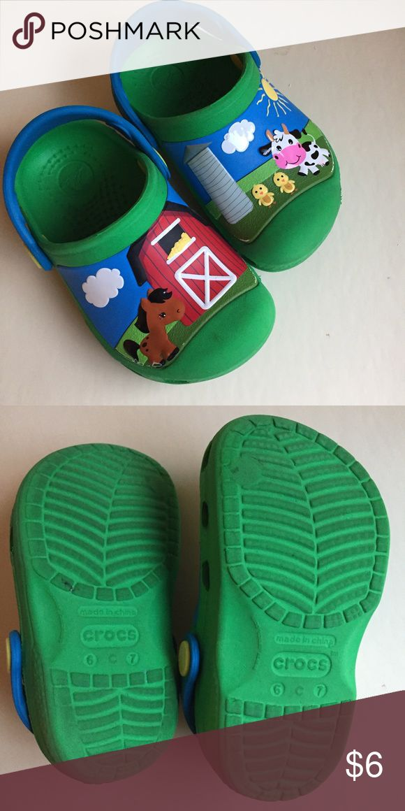 Croc Shoes Toddler 6/7 For sale is a pair of used Crocs toddler shoes in a size 6/7. These are green with a farm themed scene on them. They have signs of wear including some wearing of the picture around the edges. From a non-smoking home. Thanks for looking! CROCS Shoes