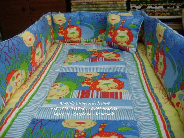 EDREDONES DE NIÑ0S - JUEGOS DE CUNA DE VARONES Set de Cuna Para Niño: Edredón, Protectores con Volantes y Lazos, sàbana esquinera, ruffled, pantalla de lámpara, cojín decorativo. A su Estilo. Por encargo. Diseño AMARILIS CISNEROS DE HERRERA - VENEZUELA +58-414-3419580 / 0241-8237413
