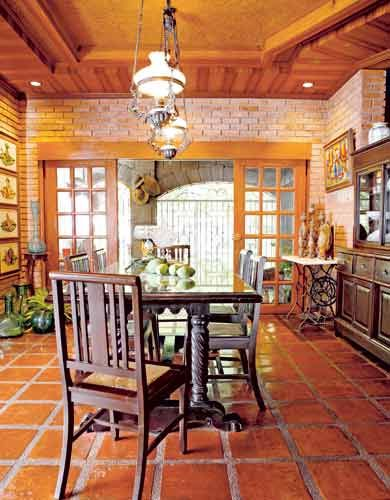 The open-plan living and dining areas are equally rustic.