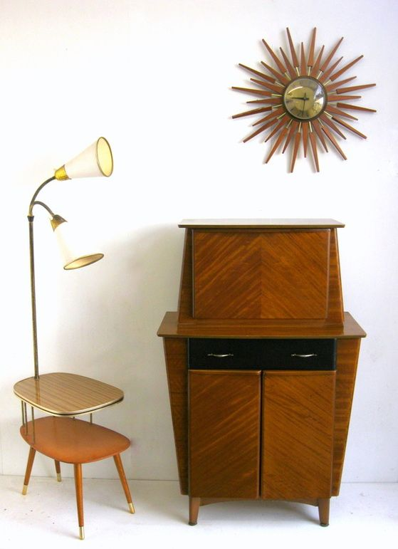 Cocktail Cabinet, atomic clock and side table with built in lamp. Love all three of these | Mid Century Modern