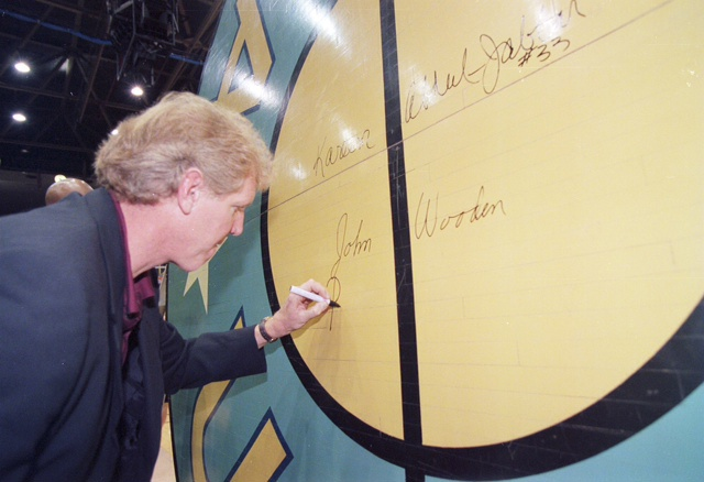 #UCLA was among 3 other No. 1 seed teams that made it to the Final Four in 2008. This UCLA center circle hit the auction block in 2011 – it's the original jump circle from the Pauley Pavilion, signed by coach John Wooden, Kareem Abdul-Jabbar, Bill Walton, and more.  #MarchMadness