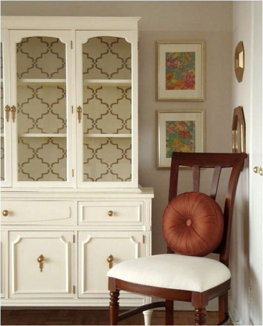 Fabulous idea for our inherited dark wood China hutch - some lovely wallpaper, or perhaps linen fabric to match the chairs (?)