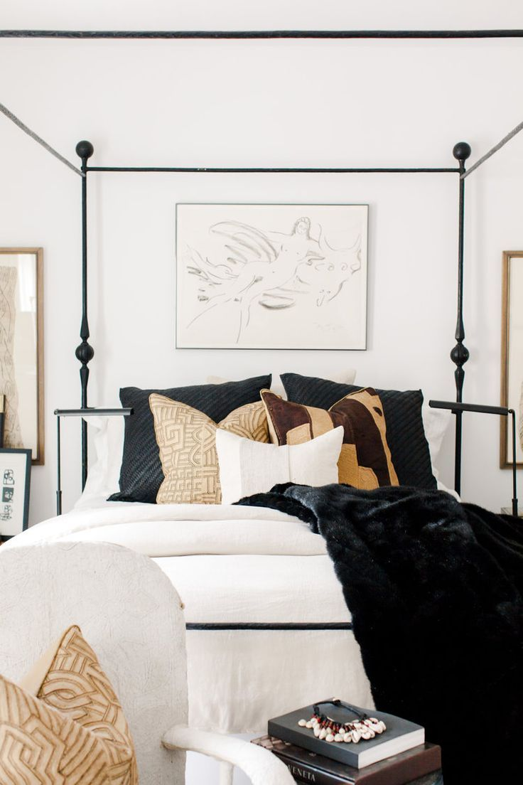 neutral bedroom decor with metal modern four poster bed
