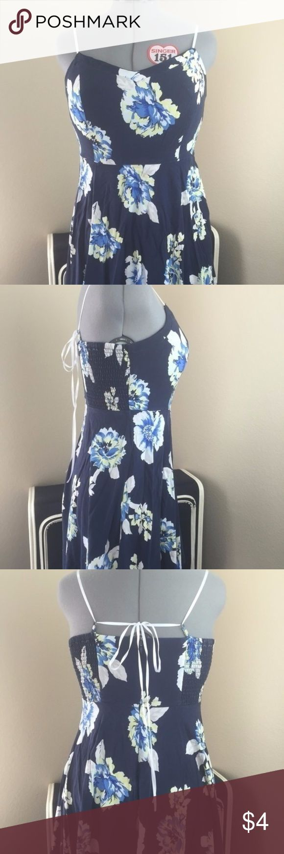 Blue and white floral skater dress Blue and white floral skater dress from Old Navy. Original straps broke so I replaced them with some cute white ribbon. Dress was worn and washed a few times but is still in good, wearable condition. Tags were removed but best fits a size 10. Old Navy Dresses Midi