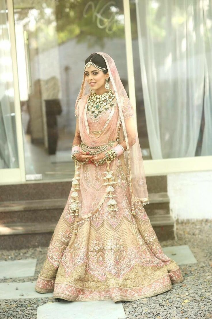 Bridal Lehengas - Pastel Peach Lehenga | WedMeGood | Pastel Lehenga with Gold and White Embroidery and Gold Kaleere, Gold and Emerald Set #wedmegood #bridal #lehengas #indianbride #indianweddings #pastel