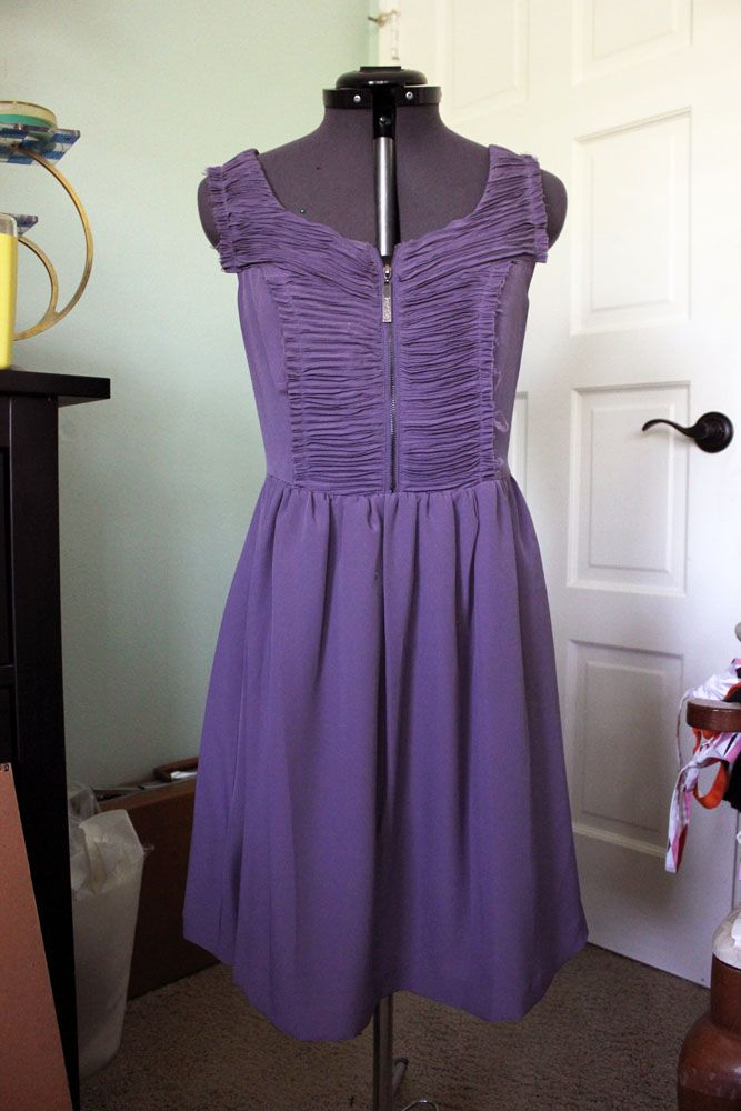 Adorable purple dress by Kensie Dresses, size 4. Has a zipper up the back as well as a zipper on the front of the chest. Has ruched detailing on the front and back with raw edges. 15 dollars plus shipping
