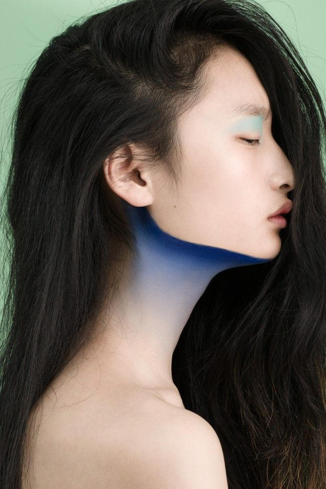 reminds me of old chinese paintings with ocean waves and nature (the blue below the neck)