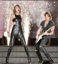 Taylor Swift and Keith Urban perform  during the 1989 World Tour on Oct. 2, 2015, in Toronto, Canada.