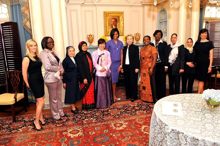 U.S. Secretary of State Hillary Clinton and First Lady Michelle Obama stands with (L to R): Reese Witherspoon, the Women of Courage honorees, and Andrea Jung at the 2010 International Women of Courage Awards at the U.S. Department of State, Washington,...
