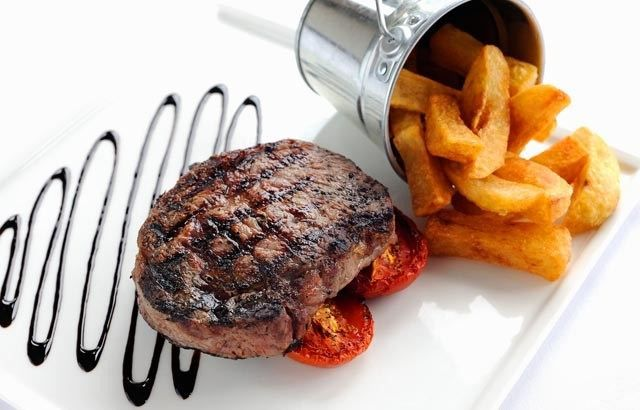 Rib Eye with Chunky Fries, Roasted Tomatoes, and Balsamic Glaze