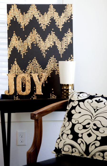 In the fall, we always get the urge to glam up our homes a bit. As always, we wanted an easy project that only cost a little. We grabbed some gold thumb tacks at The Dollar Tree and a black piece o...