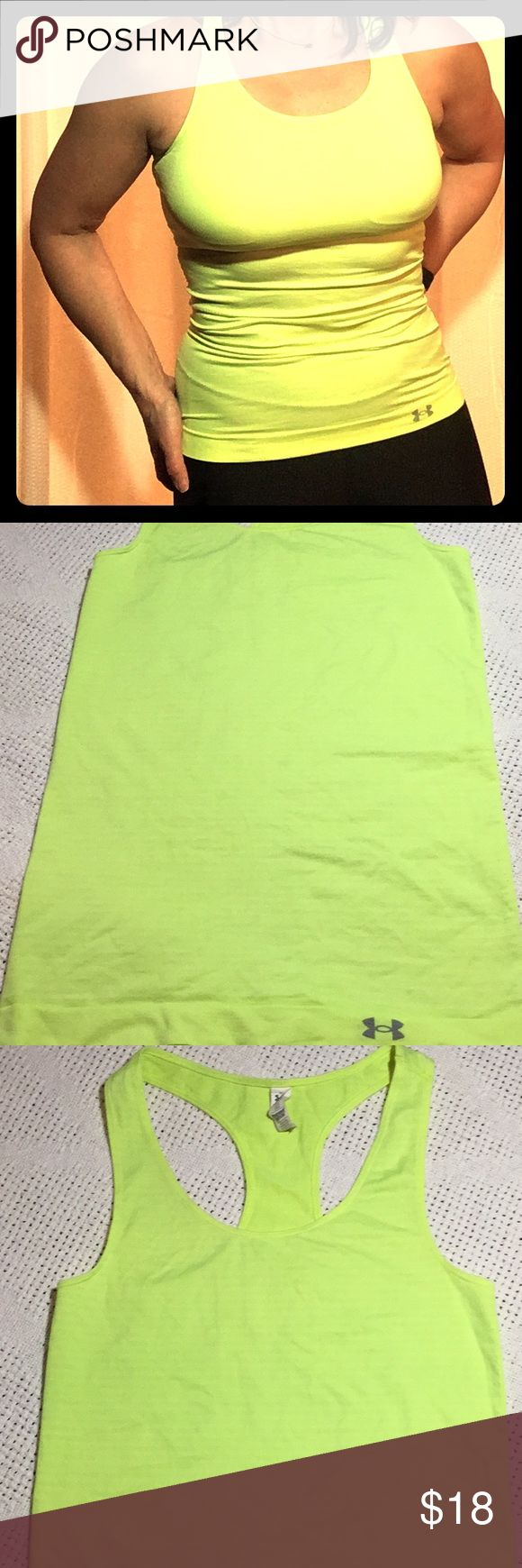 Under Armour Heatgear Fitted Tank Size XS Yellow In good condition.  Citron Racerback Under Armour Tank. When laid flat chest measures 12.5 inches and length measures 24.5 inches. Used item: pictures show any signs of wear or use. Bundle up!  Offers welcome! Under Armour Tops Tank Tops