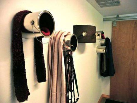 The insides of the cans hold all of your smallish accessories like gloves and mittens. The metal handle of the can is a great place for hanging scarves or wet socks. Coats are hung over the body of the can.