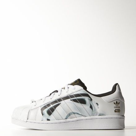 These iconic shell-toe shoes harness the power of the Force with a  Stormtrooper graphic, Star Wars™ lace clips, and a printed adidas ...
