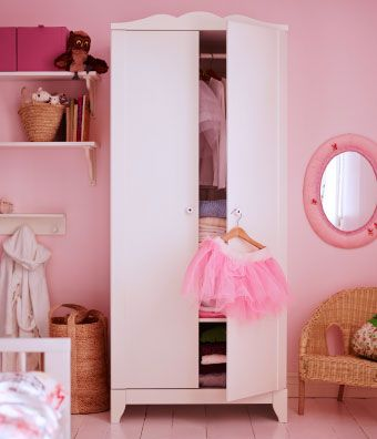 A white wardrobe in a children's room