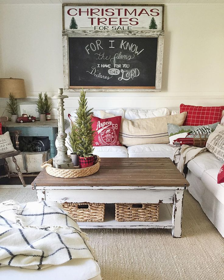 """Liz Marie Blog on Instagram: """"Christmas is slowly coming to our lower level living room. I have something exciting to hang on that wall soon, but I'm loving all the pops of read & how cozy the space is looking so far. I got this amazing tree sign from @featherandbirch & I'm a little obsessed with it! It really is the icing on the cake. Can we leave Christmas decor up all year please?!? Happy Thursday friends! #LMBhome [tap photo for sources]"""""""