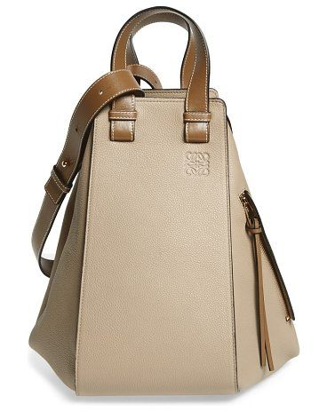 medium hammock calfskin leather shoulder bag by Loewe. A relaxed silhouette furthers the vintage '70s vibe of a roomy leather hobo styled with gleaming zippers that release to adjust the shape and capacity of the bag. Carry it by the double handles or sling it over your shoulder with the adj... #loewe #bags