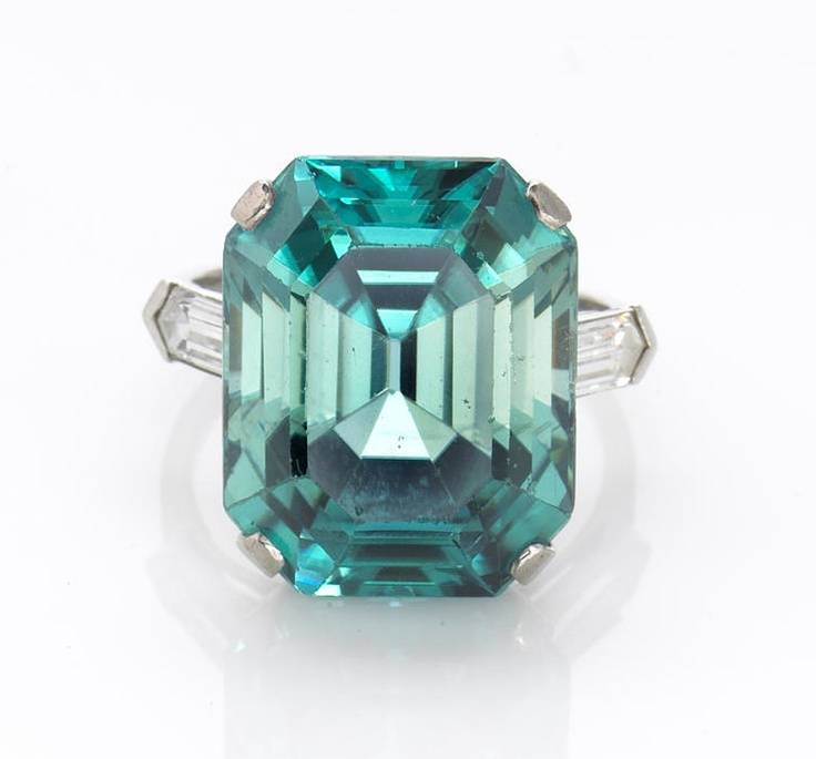 A blue zircon and diamond ring, Marcus & Co.  signed Marcus, accompanied by a signed box; modified rectangular-cut zircon weighing approximately: 22.0 carats; mounted in platinum