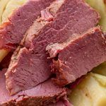 Instant Pot Corned Beef Cabbage is absolutely delicious. Make this classic St. Patrick's Day Irish meal. Pressure cooker corned beef brisket and cabbage is a dump and start recipe! simplyhappyfoodie.com #instantpotrecipes #instantpotcornedbeefandcabbage #instantpotcornedbeef #instantpotbrisket #pressurecookerbrisket